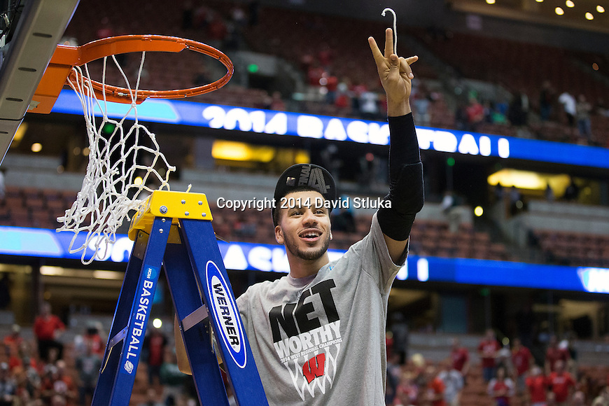 Wisconsin Badgers Traevon Jackson cuts down a piece of the net after the Western Regional Final NCAA college basketball tournament game against the Arizona Wildcats Saturday, March 29, 2014 in Anaheim, California. The Badgers won 64-63 (OT). (Photo by David Stluka)