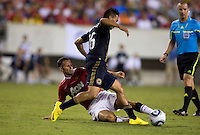 Ryan Giggs (11) of Manchester United tackles the ball away from Michael Orozco Fiscal (16) of Philadelphia Union during a friendly match at Lincoln Financial Field in Philadelphia, Pennsylvania.  Manchester United defeated Philadelphia Union, 1-0.