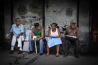 Havana, Cuba, sept 2014. Street sellers of cigar, bendages and envelops. Daily scene in the streets of a neighborhood named Center Havana.                In recent years, Raul Castro has made several economic measures for the people of the island. Cubans can now buy and sell apartments or cars, can stay in hotels on the island and can travel abroad with minor difficulties. Most of the global economists believe that these changes are moving in the right direction but its positive effects on people are very slow. Cubans continue to struggle daily through the streets of Havana with humor and zest for life.                                  En los ultimos años Raul Castro ha realizado varias medidas economicas para el pueblo de la isla. Ahora los cubanos pueden comprar y vender departamentos o coches, pueden alojarse en hoteles de la isla y pueden viajar al extranjero con menores dificultades. La mayor parte de los economistas mundiales consideren que estos cambios se mueven en la justa direccion pero sus efectos positivos sobre la gente son muy lentos. Los cubanos siguen luchando a diario por las calles de La Habana con humorismo y ganas de vivir.
