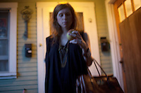 With apple in hand, Los Angeles-based singer-songwriter Cameron Mesirow leaving her home in the Los Feliz section of Los Angeles, California, June 16, 2009. Mesirow created the musical project Glasser and has just released her first demo available only on vinal  or through iTunes.