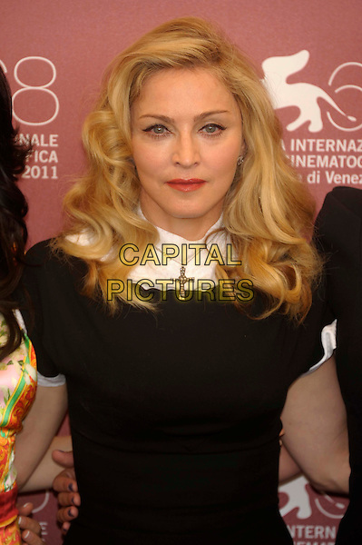 Madonna .Attending the 'W.E.' photocall at the Palazzo Del Cinema during the 68th Venice Film Festival in Venice, Italy..September 1st, 2011..portrait headshot beauty face skin red lipstick silver cross necklace  black white collar high trim sleeves  .CAP/PL.©Phil Loftus/Capital Pictures.