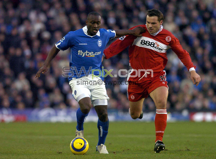 Pix by BEN DUFFY/SWpix.com.....Barclaycard Premiership football - Birmingham v Middlesborough...26/12/04....Picture Copyright >> Simon Wilkinson >> 07811267706....Birmingham's olivier tebily and Middlesborough's mark viduka chase the ball