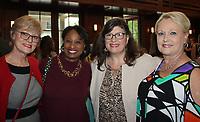 NWA Democrat-Gazette/CARIN SCHOPPMEYER Adele Coleman (from left), Monica Wilson, Rachel Krest and Martha Haguewood visit at the University Women's Giving Circle reception.
