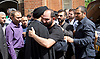 Ali Jafari's funeral prayers  <br /> Mr Ali Jafari, aged 82,  died following the fire at Grenfell Tower,<br /> 14th July 2017 <br /> <br /> Family being comforted outside the Hussaini Islamic Mission, Thornbury Road, Isleworth, <br /> <br /> Bashir Jafari on far right <br /> <br /> Hamid Jafari centre wearing black t-shirt <br /> <br /> Photograph by Elliott Franks <br /> Image licensed to Elliott Franks Photography Services