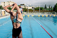 28 OCT 2003 - PAPHOS, CYPRUS - Steph Forrester stretches before beginning a training session at the British Triathlon Elite Squad Camp. (PHOTO (C) NIGEL FARROW)