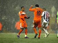Pictured L-R: Teaam mates Scott Sinclair and Danny Graham of Swansea congratulate each other after the final whistle. Saturday, 04 February 2012<br />