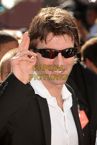 SHARLTO COPLEY .MTV Movie Awards 2010 - Arrivals held at the Gibson Amphitheatre, Universal City, California, USA, 6th June 2010..portrait headshot hand sunglasses smiling black white shirt .CAP/ADM/BP.©Byron Purvis/AdMedia/Capital Pictures.