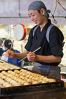 Chef Ryota Akai of Japan turns takoyaki during a demonstration of takoyaki cooking at Mitsuwa Market in Costa Mesa, California.  I love how happy he looks here :)