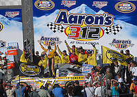 Apr 28, 2007; Talladega, AL, USA; Nascar Busch Series driver Bobby Labonte (77) celebrates after winning the Aarons 312 at Talladega Superspeedway. Mandatory Credit: Mark J. Rebilas