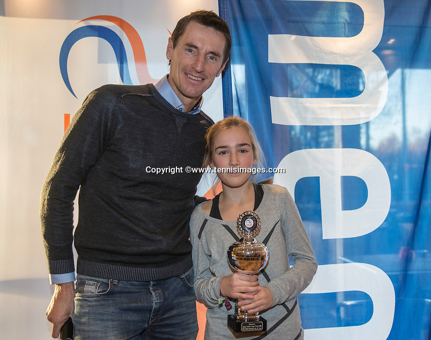 Hilversum, Netherlands, December 4, 2016, Winter Youth Circuit Masters, 3 th place girls 12 years Annelin Bakker with Fedcup captain Paul Haarhuis. <br /> Photo: Tennisimages/Henk Koster