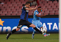 Napoli's  Camillo Zuniga     challenged by  inter's   Zdravko Kuzmanovic  during their Italian Serie A soccer match at the San Paolo stadium in Naples.  NAPOLI 05/05/2013 -.CALCIO SERIE A 2012/2013 . NAPOLI - INTER - .NELLA FOTO  ZDRAVKO KUZMANOVIC CAMILLO ZUNIGA .FOTO CIRO DE LUCA
