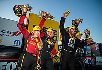 Nov 3, 2019; Las Vegas, NV, USA; NHRA top fuel driver Brittany Force, pro stock driver Erica Enders, funny car driver Matt Hagan and pro stock motorcycle rider Matt Smith celebrate after winning the Dodge Nationals at The Strip at Las Vegas Motor Speedway. Mandatory Credit: Mark J. Rebilas-USA TODAY Sports