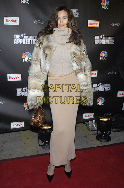 "CAROL ALT.Viewing party for ""The Celebrity Apprentice"" at Tenjune sponsored by Kodak, New York, New York, USA..February 7th, 2008.full length beige sweater knitted long skirt fur jacket top grey gray bronze bag purse .CAP/ADM/BL.©Bill Lyons/AdMedia/Capital Pictures. *** Local Caption ***"