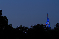 The distinctive NTT Docomo Yoyogi Building, illuminated in the evening. Seen from Yoyogi Park, Shibuya, Tokyo, Japan. Friday May 25th 2018