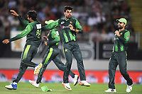 Pakistan players celebrate the wicket of Guptill.<br /> Pakistan tour of New Zealand. T20 Series.2nd Twenty20 international cricket match, Eden Park, Auckland, New Zealand. Thursday 25 January 2018. &copy; Copyright Photo: Andrew Cornaga / www.Photosport.nz