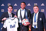 16 January 2014: Christian Dean, with head coach Carl Robinson (left) and team president Bob Lenarduzzi (right), was selected by the Vancouver Whitecaps FC with the third overall pick. The 2014 Major League Soccer SuperDraft was held at the NSCAA Annual Convention in the Pennsylvania Convention Center in Philadelphia, Pennsylvania.