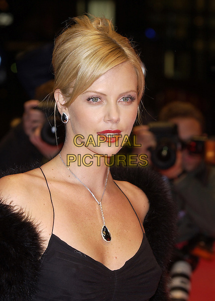 "CHARLIZE THERON.""Monster"".Berlin Film Festival, Germany.08 February 2004.portrait, headshot, red lipstick, pendant necklace.sales@capitalpictures.com.www.capitalpictures.com.©Capital Pictures"