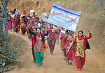 "Women march together in celebration of International Women's Day on March 8, 2016, in Dhawa, a village in the Gorkha District of Nepal. The banner reads, ""106th International Women's Day"" and ""Implement the Constitution and Guarantee Women's Rights."""