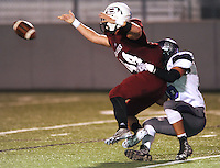 NWA Democrat-Gazette/ANDY SHUPE<br /> of Fayetteville takes down Dylan Sisemore of Springdale after a botched punt attempt Friday, Oct. 9, 2015, during the first half of play at Jarrell Williams Bulldog Stadium in Springdale. Visit nwadg.com/photos to see more photographs from the game.