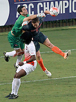 Clemson's Andrew Tarbell (22) punches the ball away from Mercer's Ian Antley (5) in the second half on Sunday.