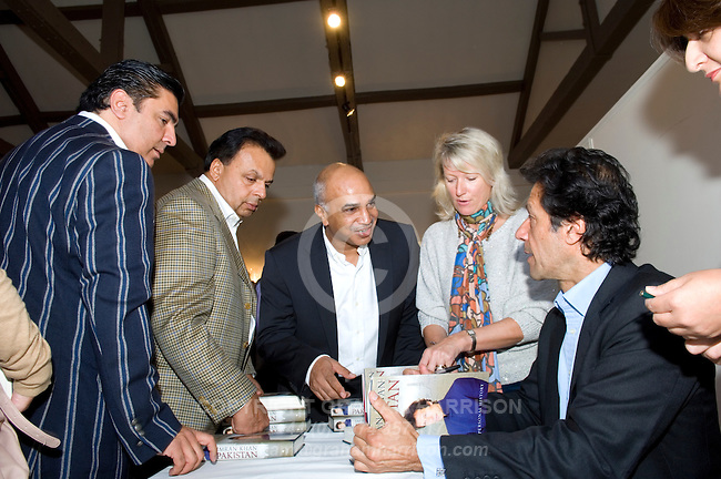 Imran Khan signing his book 'Pakistan' at Blenheim Palace during the Woodstock Literary Festival, Oxfordshire, UK, 18 September 2011...PHOTO COPYRIGHT GRAHAM HARRISON .graham@grahamharrison.com.+44 (0) 7974 357 117.Moral rights asserted.