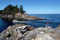 A Hiker on the Rocky Coastline of Winter Cove Provincial Park on Saturna Island, in the Southern Gulf Islands, British Columbia, Canada (Model Released)