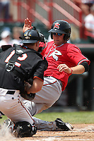 Richmond Flying Squirrels Wes Hodges #18 slides into catcher Bryan Holaday #12 during a game against the Erie Seawolves at Jerry Uht Park on July 27, 2011 in Erie, Pennsylvania.  Richmond defeated Erie 4-2.  (Mike Janes/Four Seam Images)