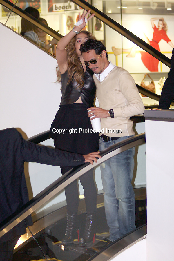 May 3rd 2011 EXCLUSIVE..Marc Anthony was drinking beer & flirting with girls while Jennifer was signing autographs. Marc kept one of his hands deep in his pocket while drinking & smoking cigarettes talking with a lady who wasn't wearing shoes .Jennifer Lopez aka JLO signing autographs & taking pictures with fans at the Hard Rock Café restaurant in Hollywood California. JLO was hugging fans wearing black leather boots & a all black out fit waving and smiling at the crowd with Marc Anthony ...AbilityFilms@yahoo.com.805-427-3519.www.AbilityFilms.com