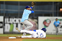 Daytona Cubs shortstop Marco Hernandez (11) attempts to turn a double play as Emilio Guerrero (13) slides in during a game against the Dunedin Blue Jays on April 14, 2014 at Florida Auto Exchange Stadium in Dunedin, Florida.  Dunedin defeated Daytona 1-0  (Mike Janes/Four Seam Images)