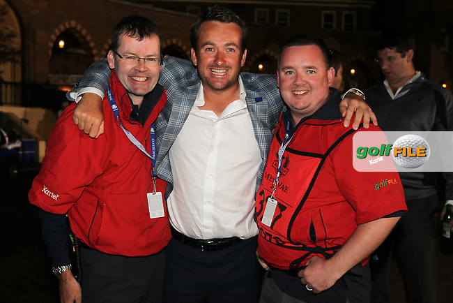 30 SEP 12  World renowned Irish Golf Photographers Eion Clarke and Fran Caffrey flank Northern Irishman Graeme McDowell enjoying the celebration after the Europeans dramatic victory at The 39th Ryder Cup at The Medinah Country Club in Medinah, Illinois.                                          (photo:  kenneth e.dennis / kendennisphoto.com)