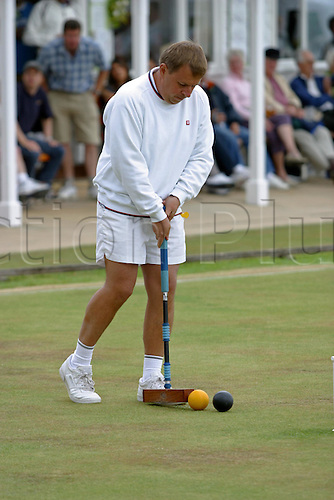 15 August 2005: English player Robert Fulford plays a shot during the Mitsubishi Motors World Croquet Championship Final against Bamford held at the Cheltenham Croquet Club, Cheltenham. Bamford beat Fulford 3-0 to win the title for the second time. Photo: Neil Tingle/Actionplus..050815 croquet ball sport