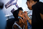 SOWETO, SOUTH AFRICA SEPTEMBER 23: An unidentified girl has her makeup up done backstage before a beauty competition on September 23, 2006 in Soweto, Johannesburg, South Africa. The competition was part of Soweto festival. Soweto is South Africa?s largest township and it was founded about one hundred years to make housing available for black people south west of downtown Johannesburg. The estimated population is between 2-3 million. Many key events during the Apartheid struggle unfolded here, and the most known is the student uprisings in June 1976, where thousands of students took to the streets to protest after being forced to study the Afrikaans language at school. Soweto today is a mix of old housing and newly constructed townhouses. A new hungry black middle-class is growing steadily. Many residents work in Johannesburg but the last years many shopping malls have been built, and people are starting to spend their money in Soweto.  .(Photo by Per-Anders Pettersson/Getty Images).