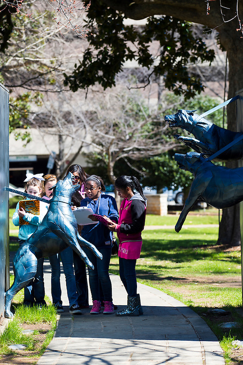 """Kelly Ingram Park, named in 1932 for local firefighter Osmond Kelly Ingram, is a four acre park located in Birmingham, Alabama. In 1992 it was completely renovated and rededicated as """"A Place of Revolution and Reconciliation"""" to coincide with the opening of the Birmingham Civil Rights Institute, an interpretive museum and research center, which adjoins the park to the west.  It is bounded by 16th and 17th Streets and 5th and 6th Avenues North in the Birmingham Civil Rights District. The park, just outside the doors of the 16th Street Baptist Church, served as a central staging ground for large-scale demonstrations during the American Civil Rights Movement of the 1960s."""