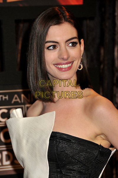 ANNE HATHAWAY.14th Annual Critics Choice Awards at the Santa Monica Civic Auditorium, Santa Monica, California, USA..January 8th, 2009.headshot portrait gold earrings strapless black white  .CAP/ADM/BP.©Byron Purvis/AdMedia/Capital Pictures.