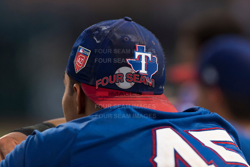 AZL Rangers Xavier Valentin (45) watches action from the dugout during an Arizona League game against the AZL Giants Black at Scottsdale Stadium on August 4, 2018 in Scottsdale, Arizona. The AZL Giants Black defeated the AZL Rangers by a score of 6-3 in the second game of a doubleheader. (Zachary Lucy/Four Seam Images)