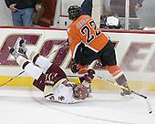 Ben Geelan 22 of Bowling Green dumps Tim Filangieri 5 of Boston College. The Eagles of Boston College defeated the Falcons of Bowling Green State University 5-1 on Saturday, October 21, 2006, at Kelley Rink of Conte Forum in Chestnut Hill, Massachusetts.<br />