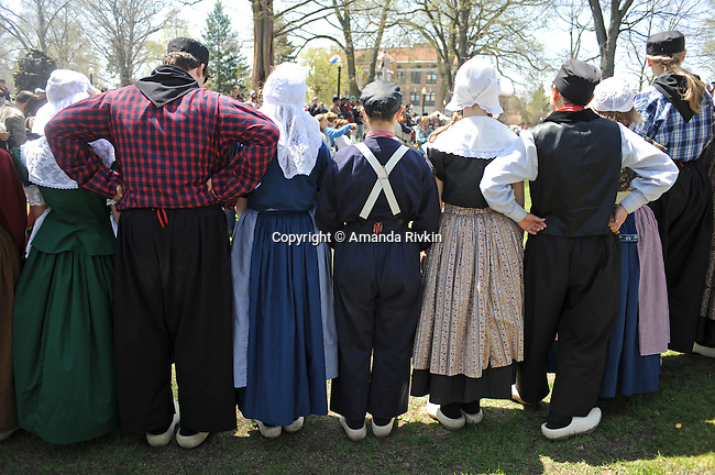 High school and schoolchildren appear in traditional Dutch costumes during a pageant during the annual Tulip Festival in Holland, Michigan on May 2, 2009.