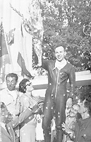 14th September 1958; Monza, Italy;  John Surtees acknowledges the cheers of the crowd after his second victory at Monza Italy