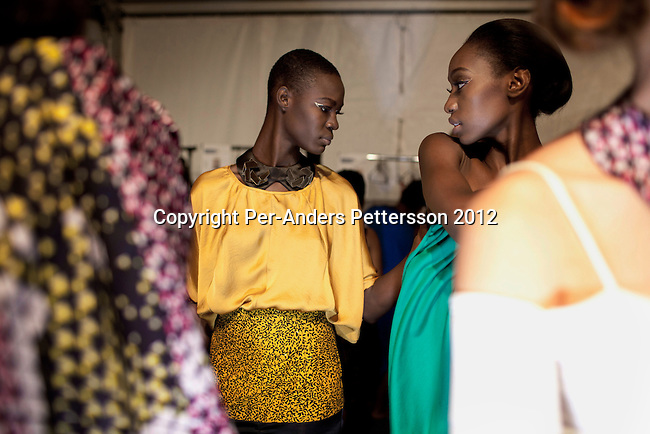 JOHANNESBURG, SOUTH AFRICA   MARCH 10: Models wait backstage before a show for the designer label Loin Cloth and Ashes at the Joburg Fashion Week on March 10 2012, at the Hyde Park Mall in Johannesburg, South Africa. South Africa's finest designers showed their 2012 Autumn & Winter collections during the four day event. (Photo by Per-Anders Pettersson)