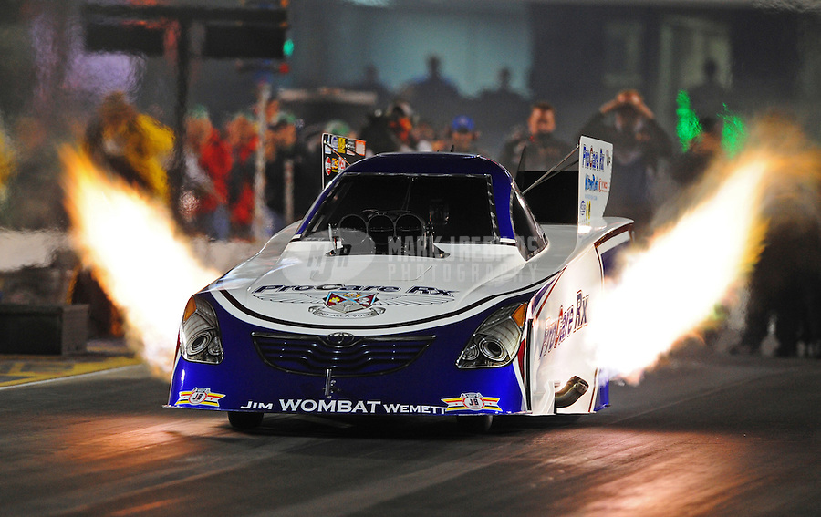 Sept. 16, 2011; Concord, NC, USA: NHRA funny car driver Melanie Troxel during qualifying for the O'Reilly Auto Parts Nationals at zMax Dragway. Mandatory Credit: Mark J. Rebilas-