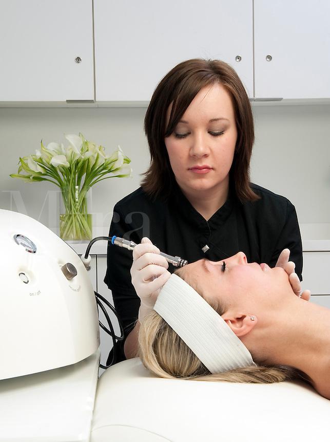 Dermaplaning cosmetic procedure.