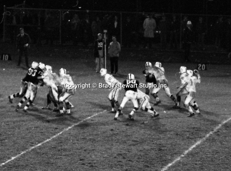 Bethel Park PA:  Offensive play with Mike Stewart throwing a pass to Bruce Evanovich,  Others in the  photo; Bruce Evanovich 80, Chip Huggins 32, Clark Miller 30, Dan Hannigan 64, Dennis Franks 66, Don Troup 51, Joe Barrett 75, Mike Stewart 11.  The Bethel Park offense and defense played very well in the 16-0 shut out of the Upper St Clair Panters.  The defensive unit was one of the best in Bethel Park history only allowing a little over 7 points a game.