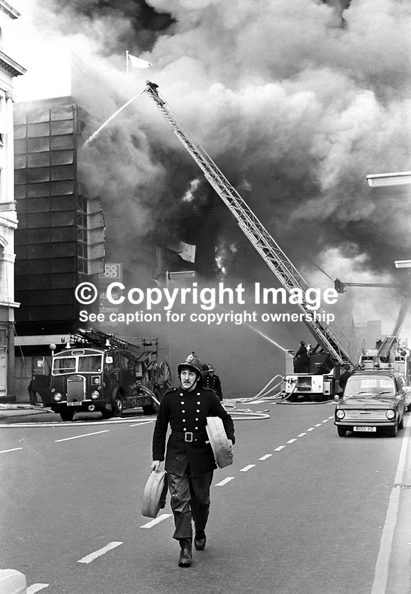 Firemen fight blaze at Belfast Co-op's main store in York Street, following the explosion of a Provisional IRA bomb. Several people were slightly injured. At the time it was stated that &pound;8M worth of damage was caused and that around 1000 jobs were endangered. NI Troubles. Ref: 19720510002 <br />