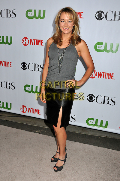 MEGYN PRICE.CBS, CW and Showtime TCA Press Tour Party 2009 held at the Huntington Library, Pasadena, CA, USA..August 3rd, 2009.full length black leather skirt slit split grey gray sleeveless top hand on hip.CAP/ADM/BP.©Byron Purvis/AdMedia/Capital Pictures.
