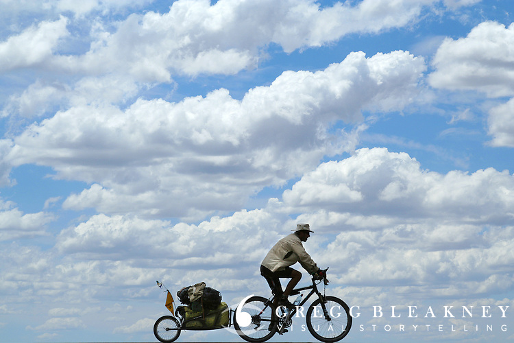 Don Thomas rides through the clouds - outside of San Rafael - Argentina