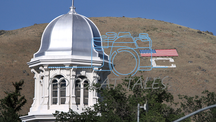 The 65' by 120' American flag on C Hill sits above the dome of the Capitol in downtown Carson City, Nev. The flag was constructed following Sept. 11, 2001 to show community patriotism.<br /> Photo by Cathleen Allison