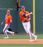 Third baseman Jay Baum (13) of the Clemson Tigers in a game against the South Carolina Gamecocks on Saturday, March 2, 2013, at Fluor Field at the West End in Greenville, South Carolina. Clemson won the Reedy River Rivalry game 6-3. (Tom Priddy/Four Seam Images)