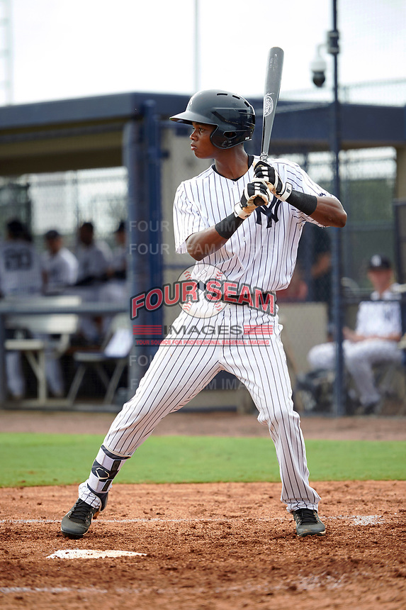 GCL Yankees East shortstop Jose Devers (5) at bat during the first game of a doubleheader against the GCL Yankees West on July 19, 2017 at the Yankees Minor League Complex in Tampa, Florida.  GCL Yankees West defeated the GCL Yankees East 11-2.  (Mike Janes/Four Seam Images)