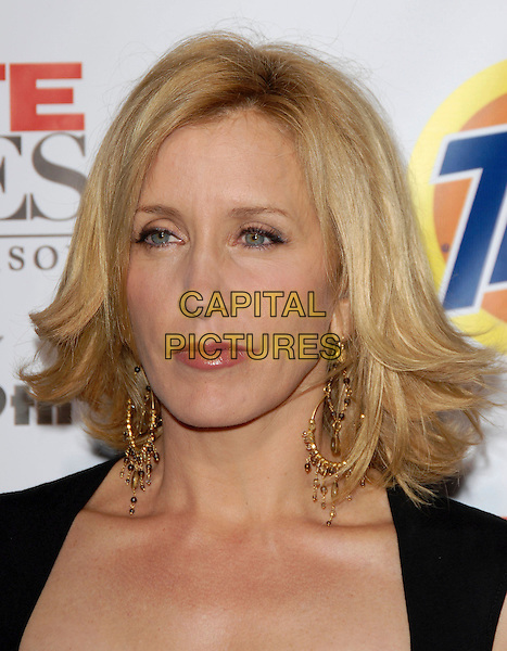 FELICITY HUFFMAN.The Desperate Housweives: Extra Juicy Season 2 DVD Launch held at Wisteria Lane in Universal City, California, USA..August 5th, 2006.Ref: DVS.headshot portrait gold earrings.www.capitalpictures.com.sales@capitalpictures.com.©Debbie VanStory/Capital Pictures
