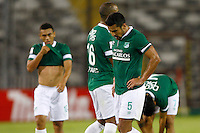 SANTIAGO-CHILE -19-02-2014. Los jugadores de Deportivo Cali de Colombia dejan la cancha despues del partido contra O'Higgins de Chile por la segunda fase, grupo 3 de la Copa Libertadores de America en el estadio Monumental de Santiago, Chile./ Deportivo Cali's of Colombia players leave the pitch after the match against O'Higgins of Chile for the second phase, group 3 of the Copa Libertadores championship football match held at Monumental stadium in Santiago, Chile.   Photo: VizzorImage/ Andres Pina /Photosport